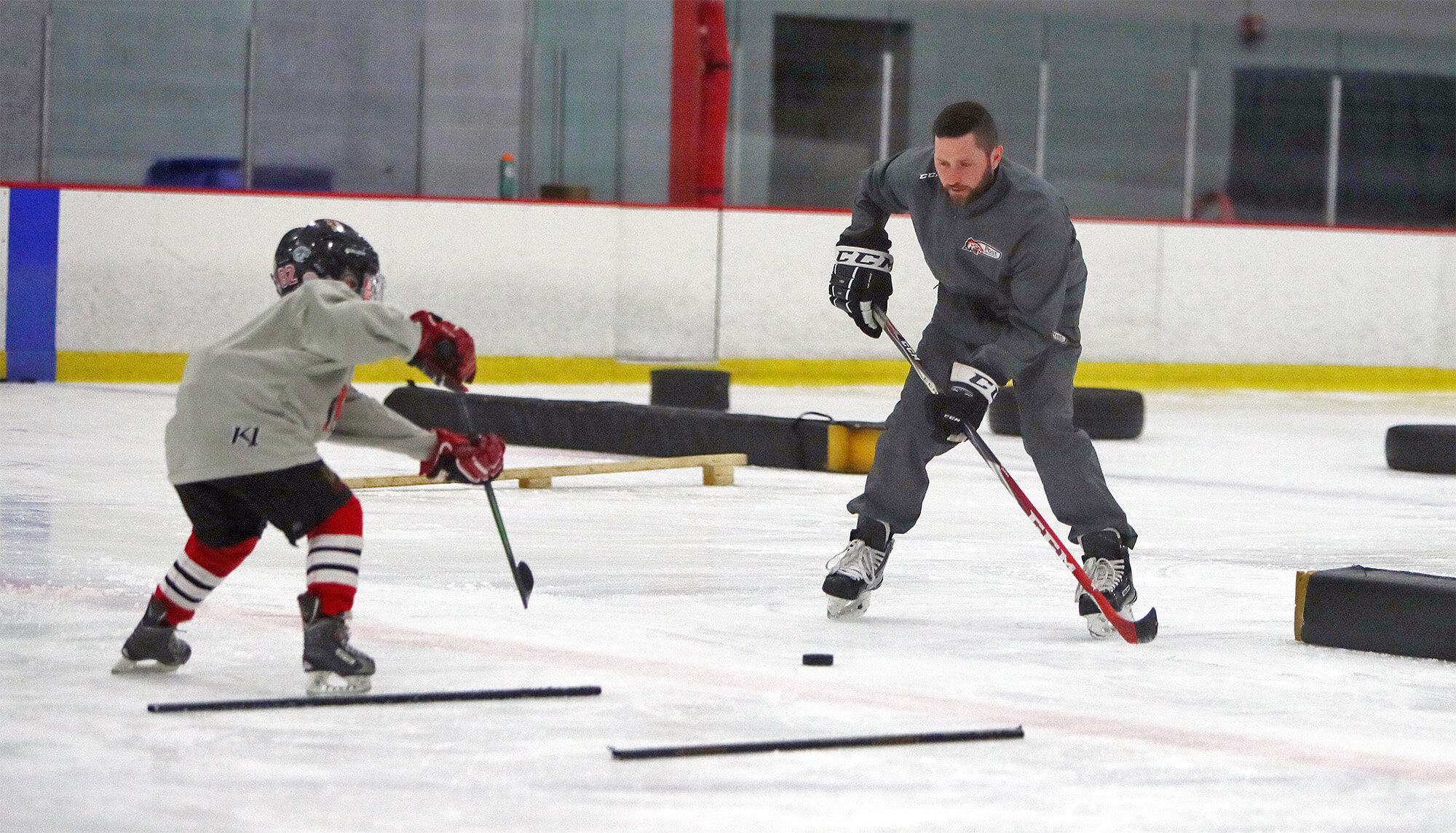 Duncan Rutsch works with Tim Richter of IPH Hockey